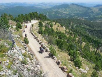 Biking in the mountains at Black Hills Cabins & Motel at Quail's Crossing.