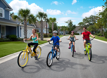 Family biking at North Beach Plantation.