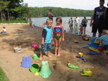 Playing on the beach at White Birch Village Resort.