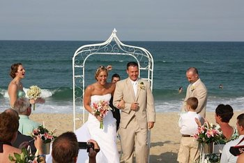 Wedding couple on beach at Oasis Suites.