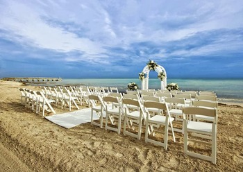 Wedding on the beach at The Reach Resort.