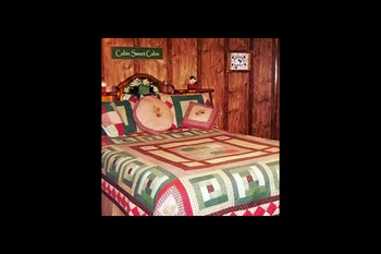 Cabin bedroom at Pine Lodge Cabins & Suites.