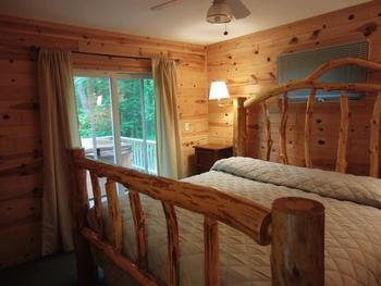 Cabin bedroom at Acorn Hill Resort.