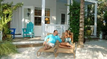 Couple relaxing on beach at Parrot Key Resort.