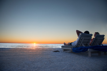 Lounging on the Beach at TradeWinds Island Grand