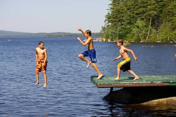 Jumping of the dock at New England Outdoor Center.