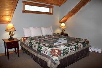 Cabin bedroom at Ampersand Bay Resort.