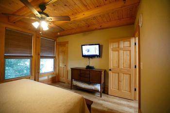 Cabin bedroom at Geronimo Creek Retreat.
