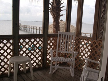 Beachfront cabin porch at Navarre Beach Campground.