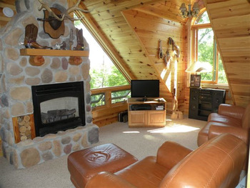 Cabin living room at Northern Lights Resort Outfitting & Youth Quest.