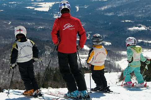 Family skiing at Stowe Mountain Lodge.