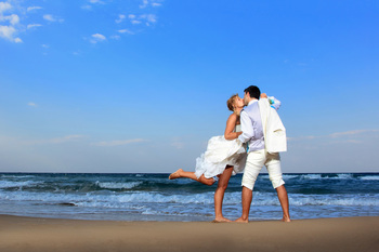 Wedding on the beach at Beacher's Lodge Oceanfront Suites.