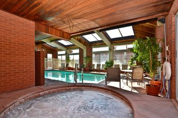 Indoor pool and hot tub at Best Western Coral Hills.