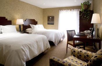 Main double with courtyard patio at Ascend Hotel Collection-The Woodlands Inn.