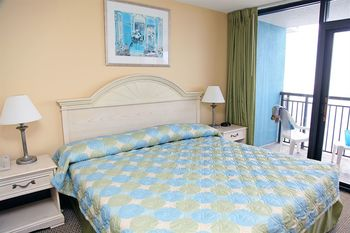 Vacation rental bedroom at Grande Shores Ocean Resort.