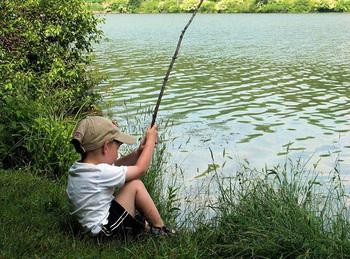 Kid fishing at Wilderness Resort Villas.