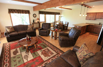 Living room and dining room at East Silent Lake Vacation Homes.