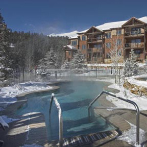 Outdoor pool at Grand Timber Lodge.