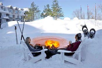 Relax by the bonfire at JW Marriott The Rosseau Muskoka Resort & Spa.