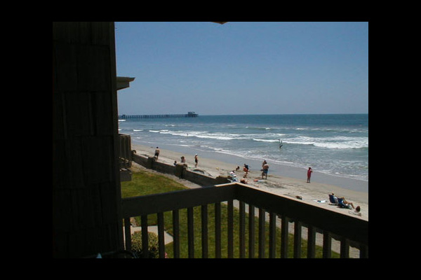 Beach view at Azure Pacific Vacation Rentals.