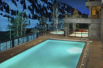 Outdoor heated pool, and indoor/outdoor Jacuzzi at Alta's Rustler Lodge.
