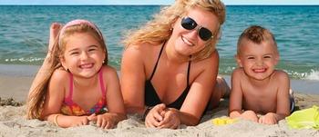 Family On Beach at Water's Edge Resort