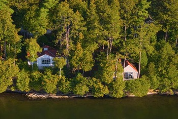 Cottages facing the lake at Basin Harbor Club.