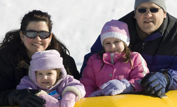 Family snow tubing at Fernwood Resort.