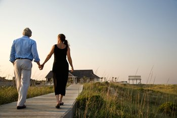 Couple on boardwalk at Williamson Realty. Inc.