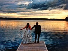 Wedding couple on the dock at Elmhirst's Resort.