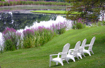 Chairs by Lake Clair at The Country Place Resort.