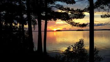 Sunset on the lake at Birch Forest Lodge.