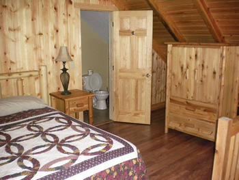 Cabin bedroom at Harman's Luxury Log Cabins.
