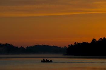 Fishing on the lake at Anderson's Starlight Bay Resort.