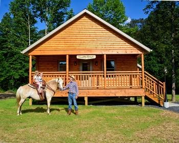 Family outside cabin at Creekside Resort.