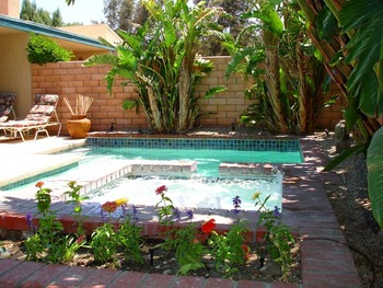Outdoor pool at Private Villa Management.