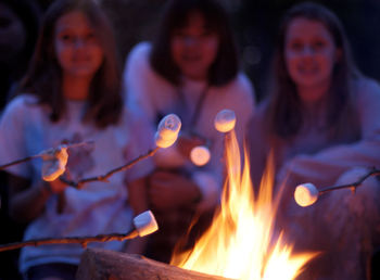Group roasting marshmallows at Arrowwood Resort and Conference Center.