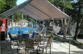 Poolside patio at Calm Waters Resort.