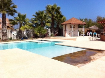 Outdoor pool at Sea Breeze Suites Port Aransas.