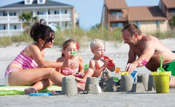 Family on Myrtle Beach at Mar Vista Resort Grande.