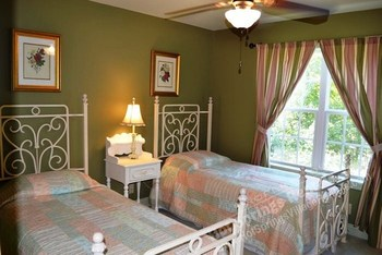 Double beds at Hot Springs Village Rentals.