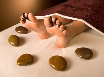 Hot stone massage at Rusty Parrot Lodge.