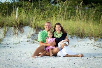 Family on beach at Lizzie Lu's Island Retreat.