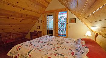 Cabin bedroom at Natapoc Lodging.