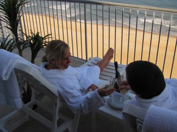 Honeymoon couple enjoying the beach view at Grand Hotel & Spa.