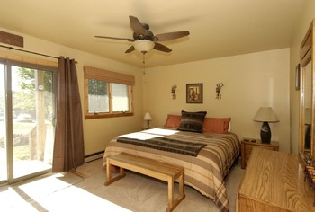 Vacation rental bedroom at Timberline Herzwoods and Northwoods Resort.