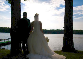 Wedding couple at the lake at Woodloch Resort.