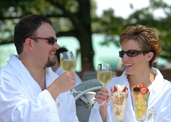 Enjoy a toast to bathrobes and outdoor dining at the Spa at Norwich Inn.