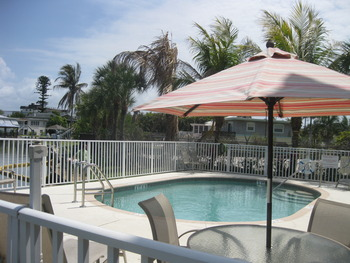 Outdoor pool at Island Breeze Vacation Rentals.