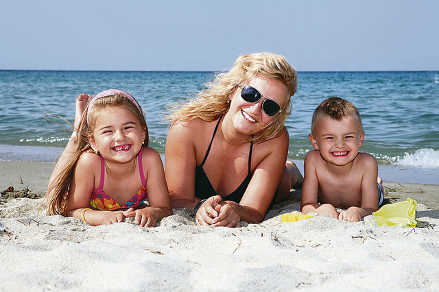 Family on the beach at Water's Edge Resort.